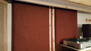ATS Acoustics sound absorbing panels installed on the right side wall.